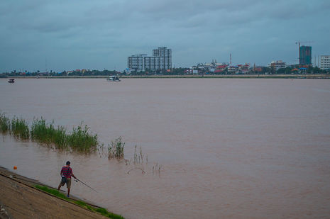 Fishing by the Mekong river in Phnom Penh, Cambodia