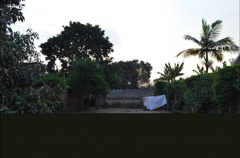 border wall and no man's land between Gisenyi, Rwanda and Goma, DRC