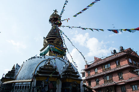 a stupa and prayer flags in Kathmandu, Nepal