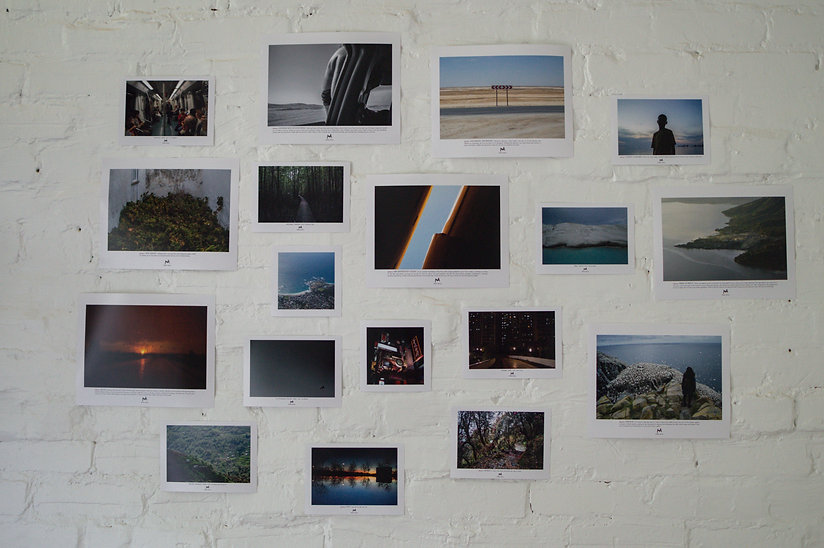 white brick wall with photographs