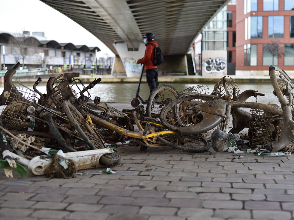 Vandalised public bikes and scooters after they have been recovered from the river in Paris, France