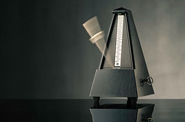 Canva - Metronome on grey background - h