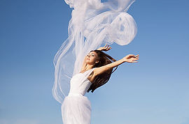 woman in the white dress above the sky_j