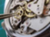 close up of watchmaker repairing a vinta