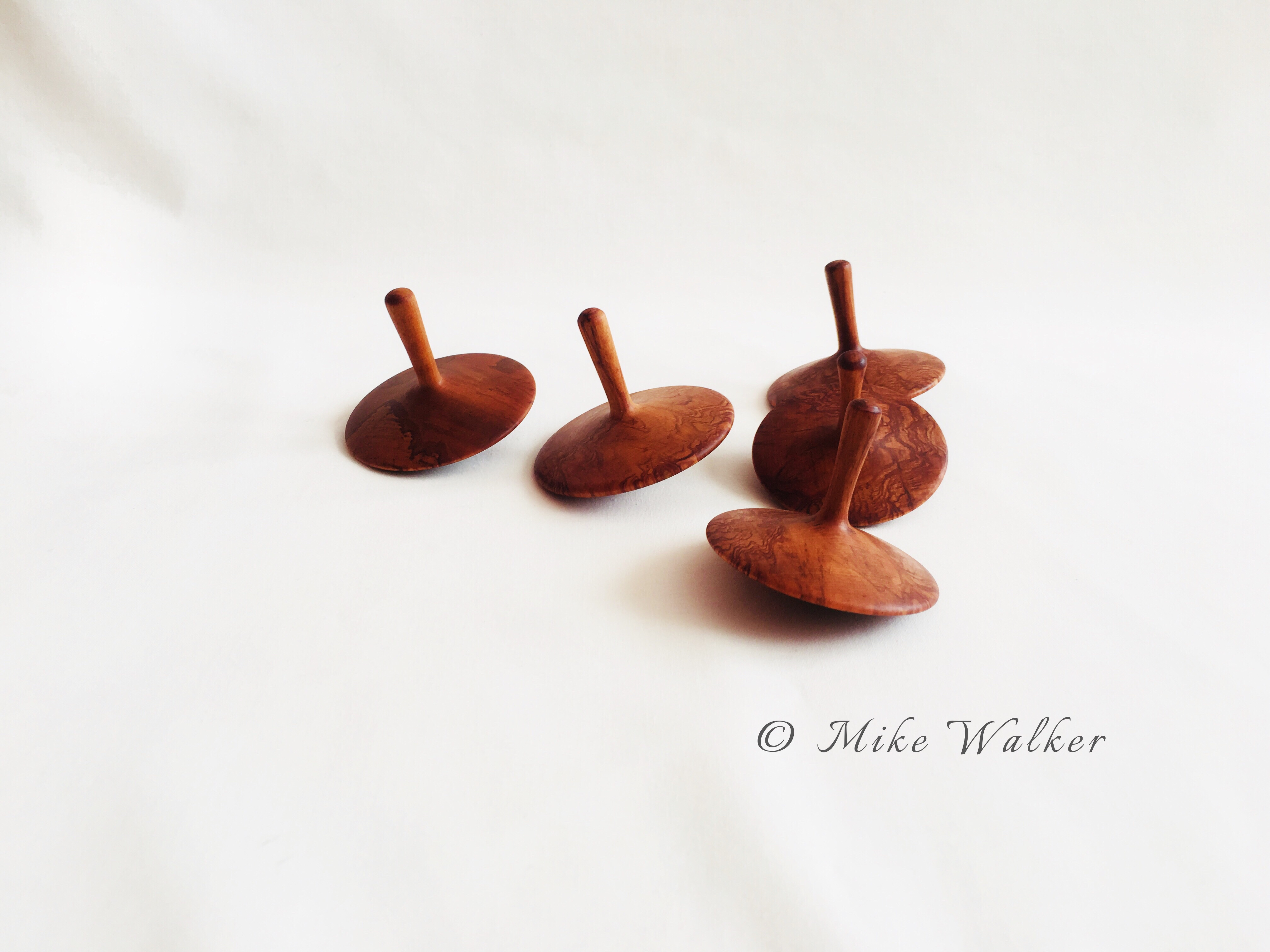 Rimu Spinning Tops
