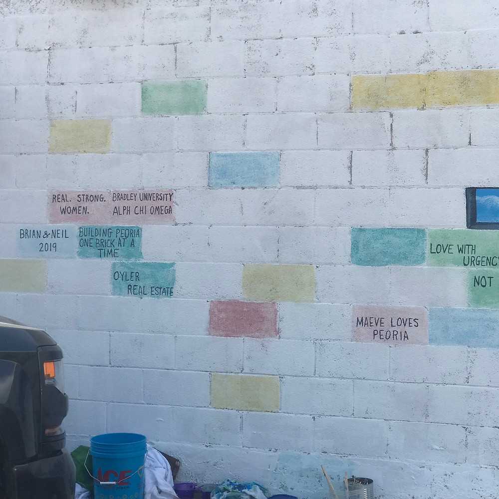 Brick wall with some color added plus messages from community members