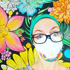 Brightly colored flower mural painted by Peoria Illinois Central Illinois muralist loveheylola Jessica McGhee