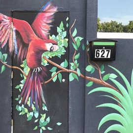 Scarlet Macaw rainforest mural downtown peoria illinois mural painted by central Illinois muralist Jessica McGhee Hey Lola loveheylola