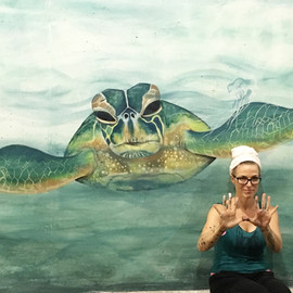 Sea turtle ocean mural in Niagara Alley Peoria Illinois painted by muralist Jessica McGhee Hey Lola