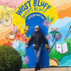 West Bluff Best Bluff mural located in Peoria Illinois by One World Cafe painted by muralist Jessica McGhee