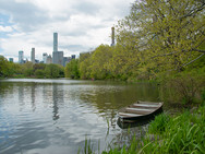 Row Boat on The Lake in Central Park with Buildings in Background