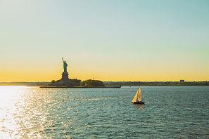 statue of liberty hudson river sunset