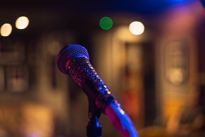 closeup-shot-microphone-blurred-space-wi