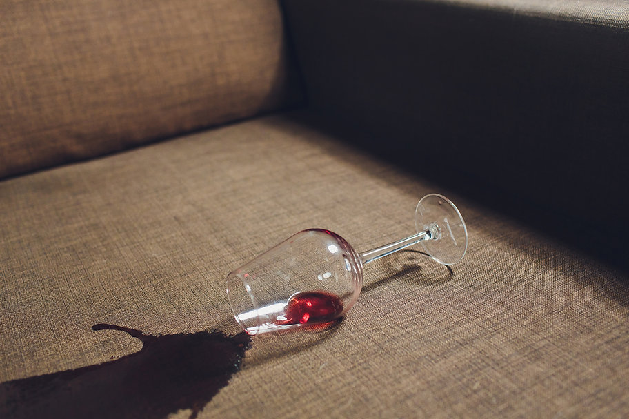 106292907-red-wine-spilled-grey-couch-so