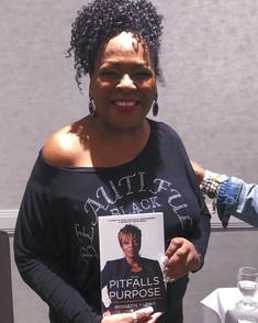 Jewel Diamond Taylor Holding My book_edited.jpg