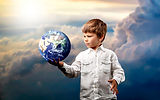 child_boy_ball_planet_imitation_clouds_1