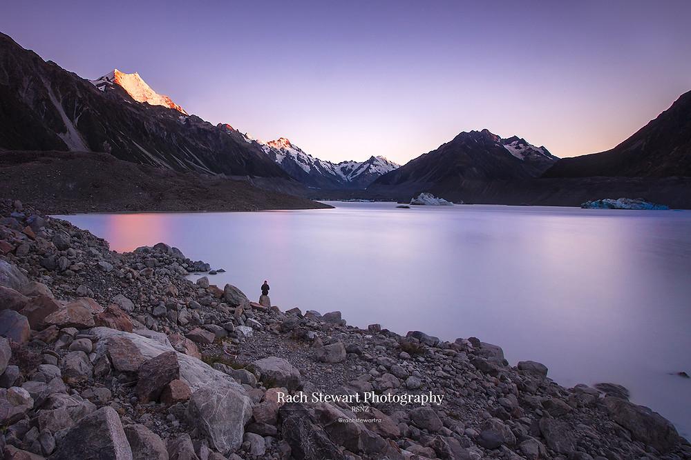 Tasman Lake sunrise long view towards Mount Cook