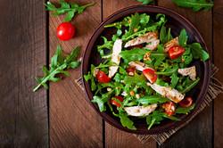Fresh salad with chicken breast, arugula