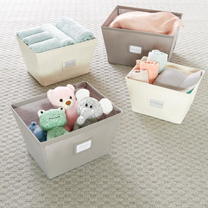 10 Things to Buy from The Container Store for a More Organized Home   Getting it Done Organizing   Open Canvas Storage Bins
