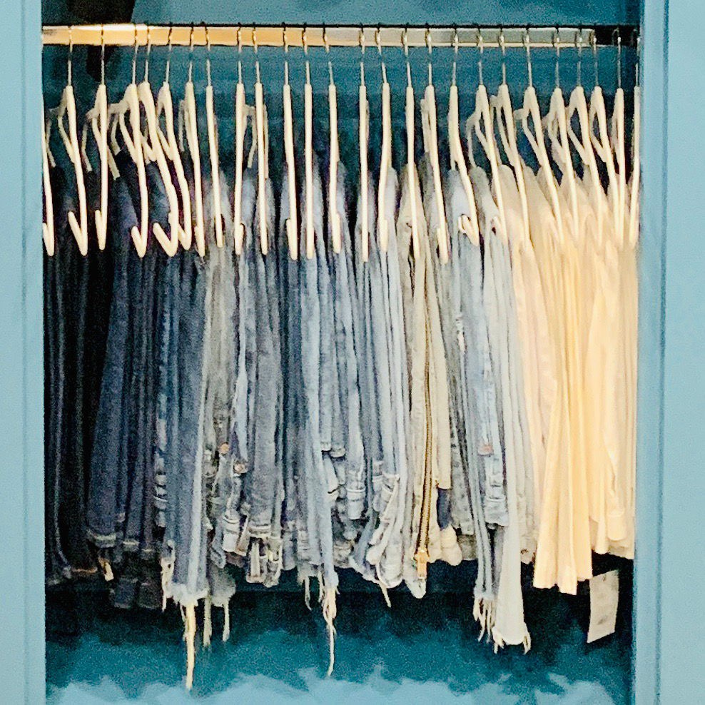 Closet organization by Jenny Dietsch at Getting it Done Organizing | Blue closet showing hanging jeans with matching velvet hangers