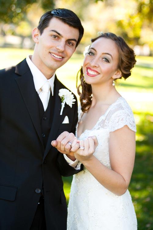pinky promise wedding rings pose