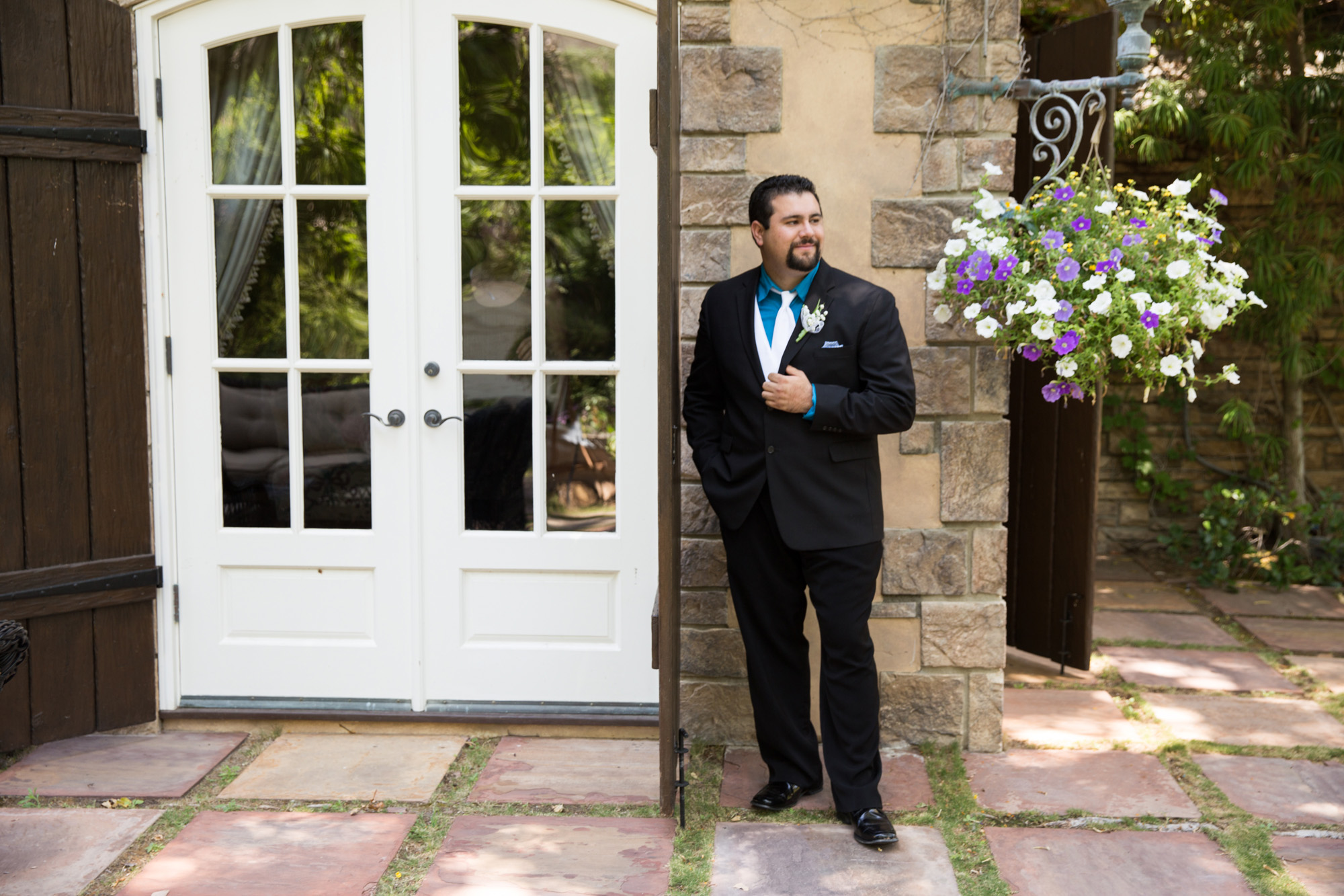 groom portrait waiting for bride