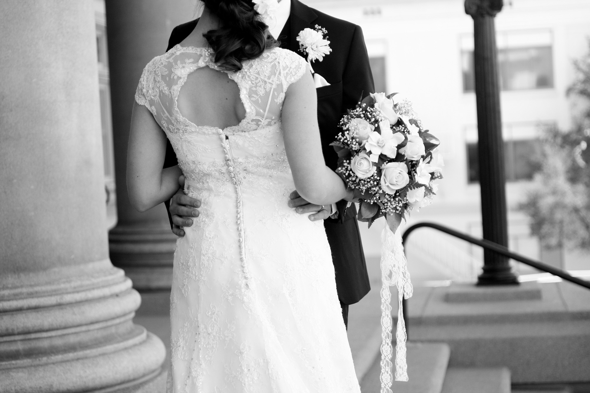 couple detail photo with bouquet