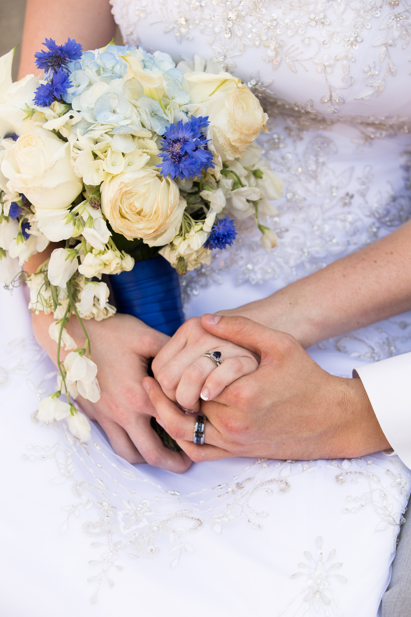 Blue wedding bouquet ring detail