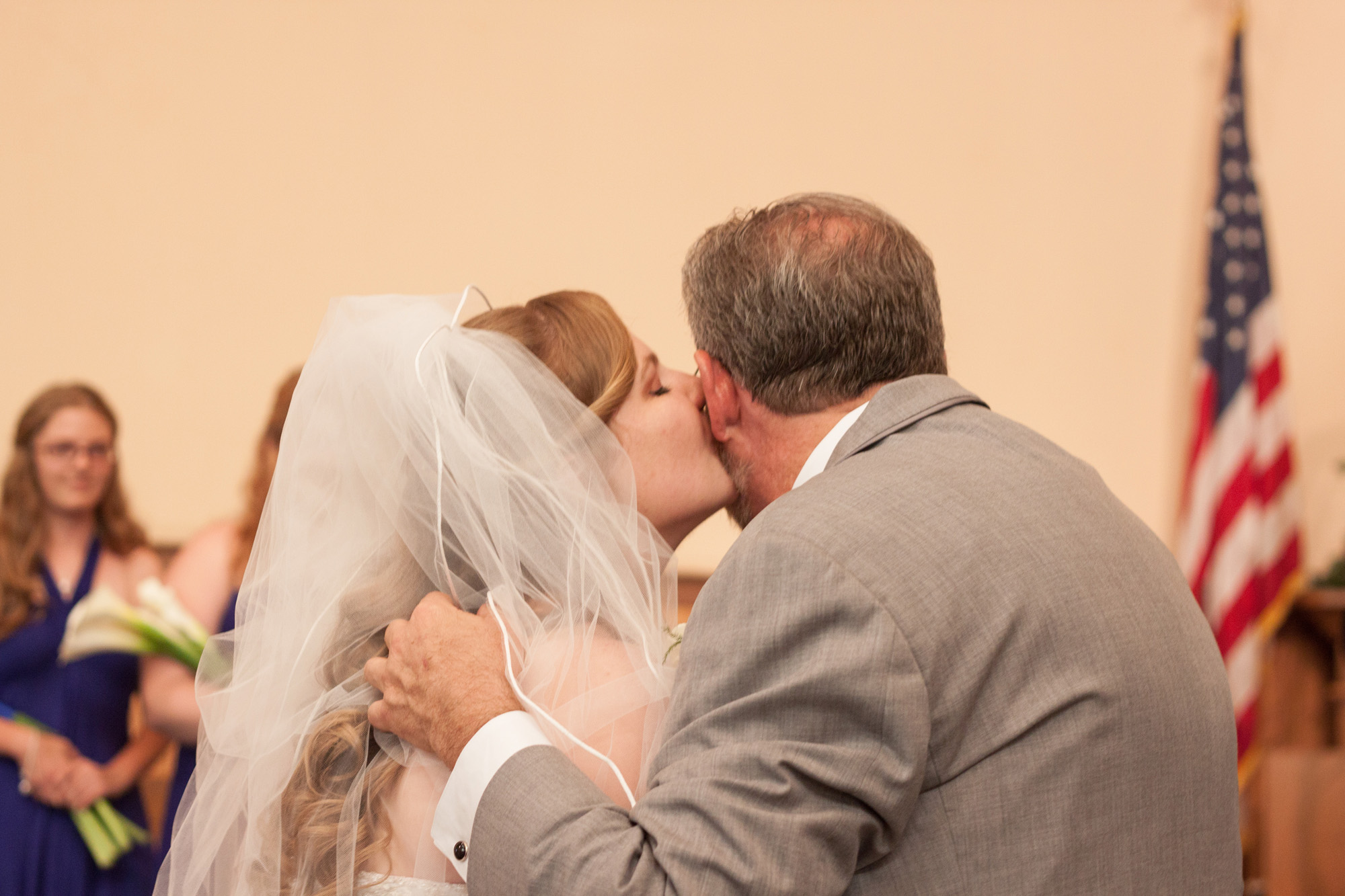 Bride kissing father in ceremony