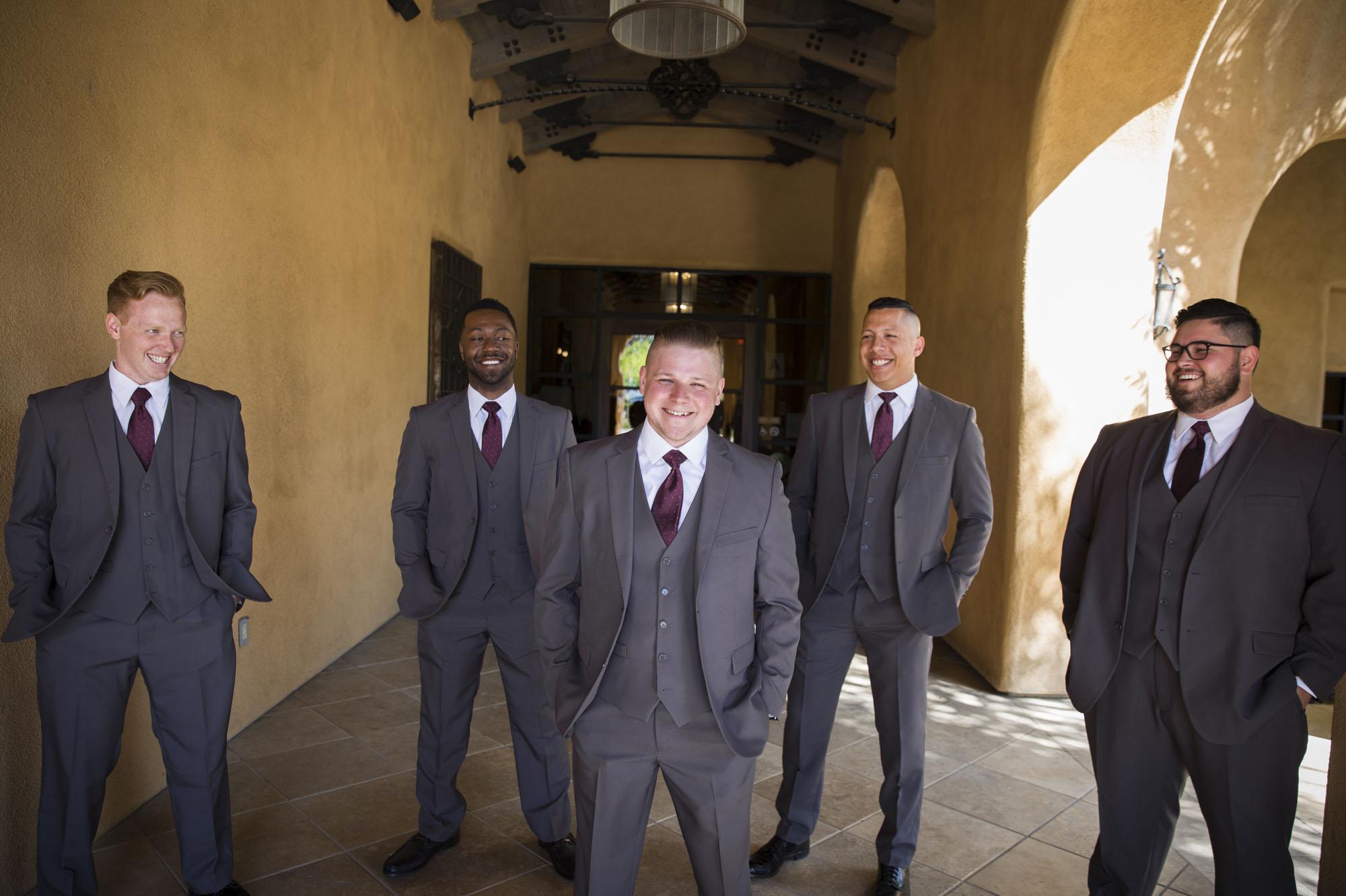 Classy groomsmen in archway