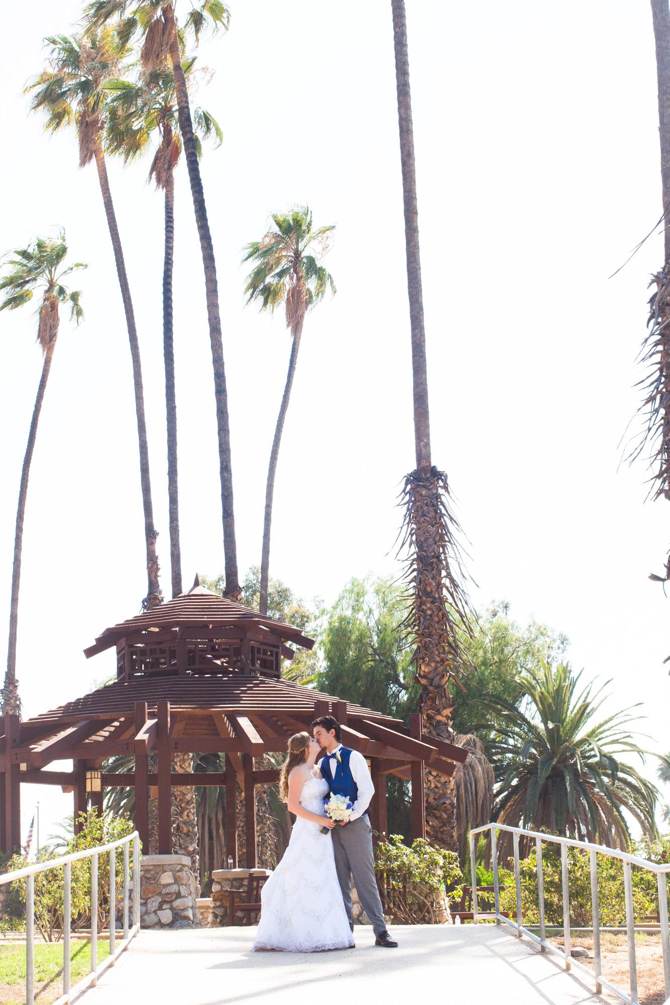 palm trees and gazebo wedding kiss