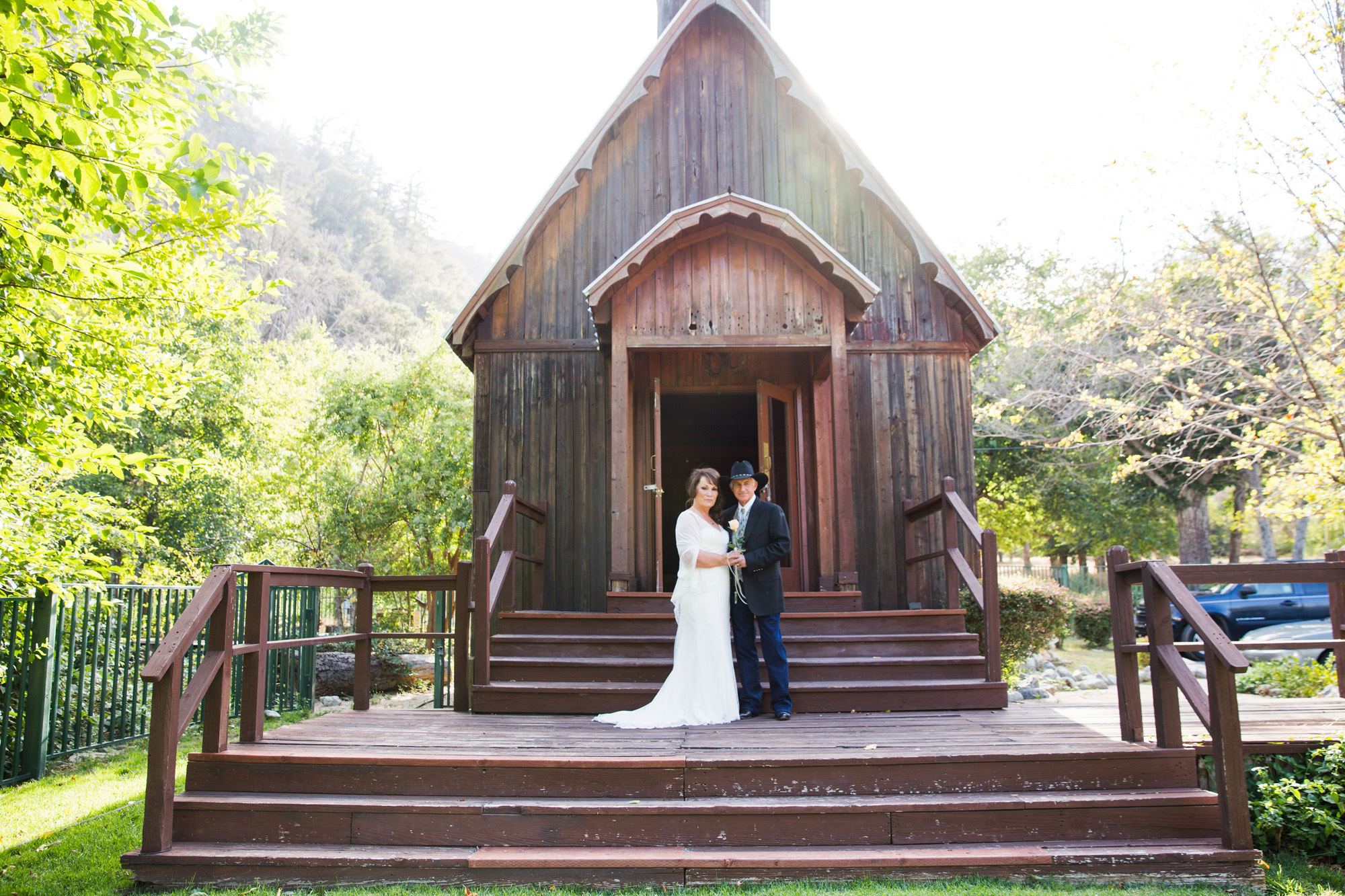 bride and groom in wooden chapel