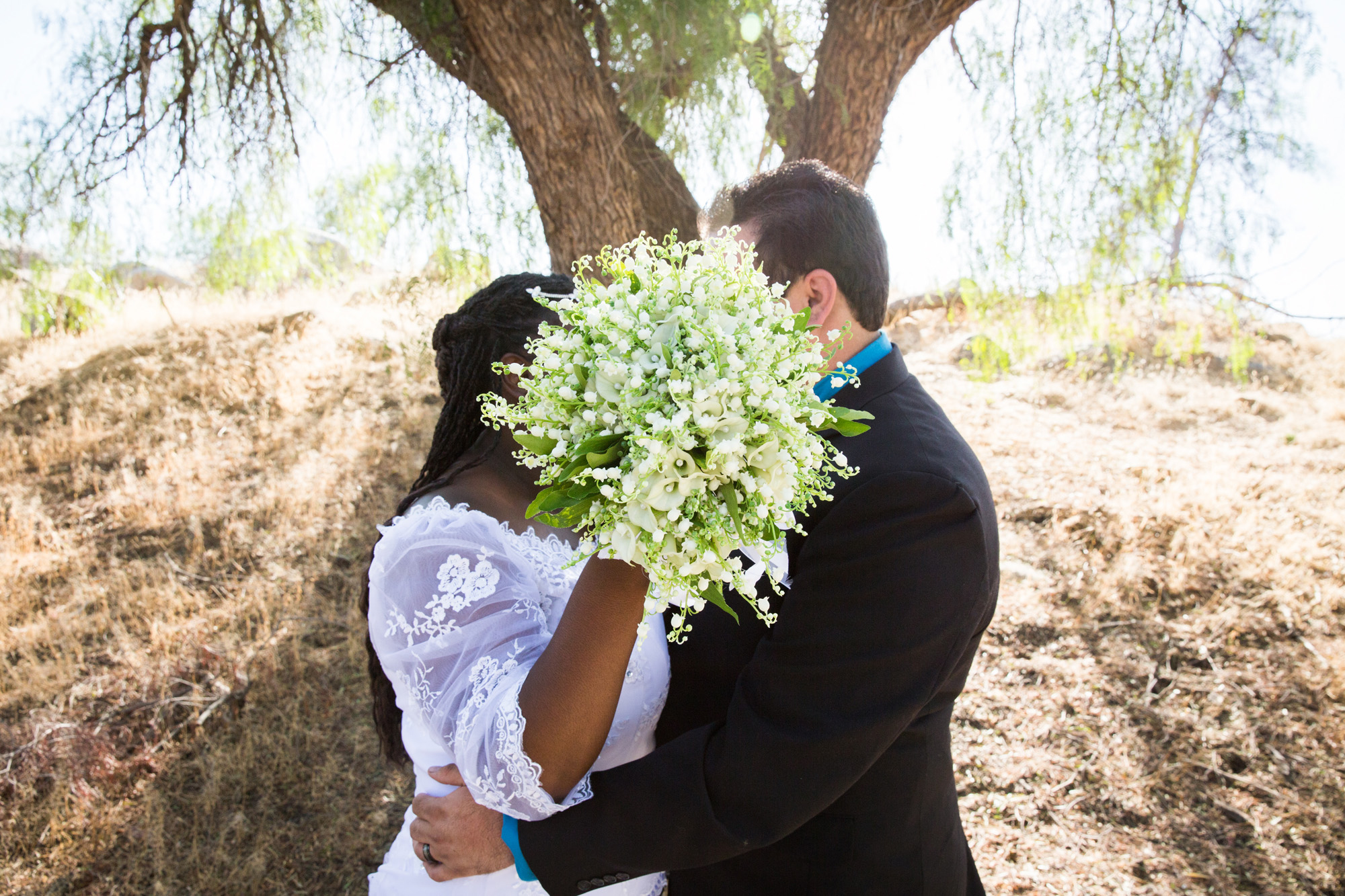 Kiss behind baby's breath bouquet
