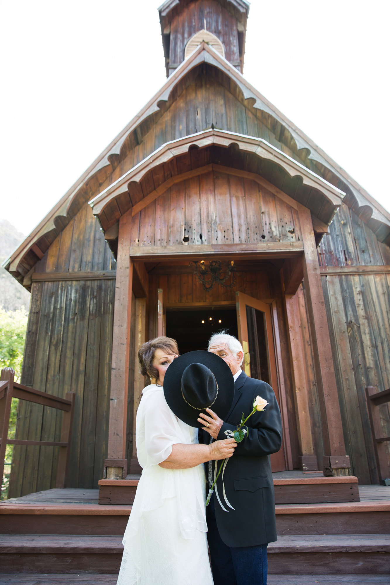 Cowboy hat kiss at old chapel