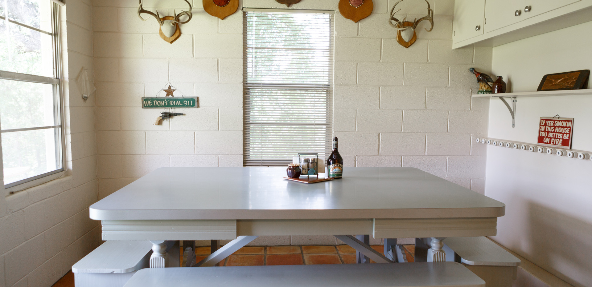 Breakfast table in fully stocked kitchen at Pecan Creek lodge for Century Ranch hunters in Llano, Texas