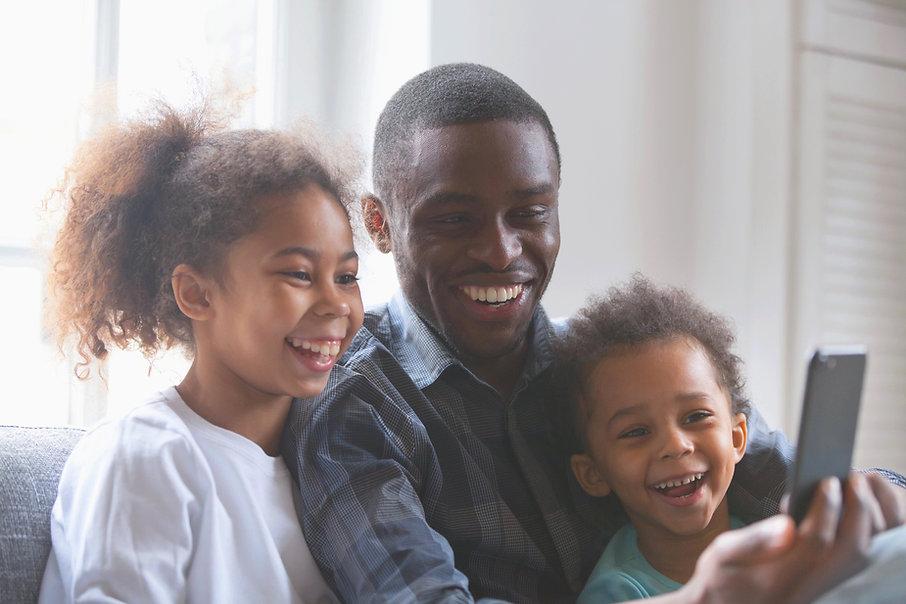 Family watching virtual church service o
