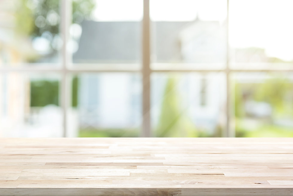 Wood table top inside the house with sun