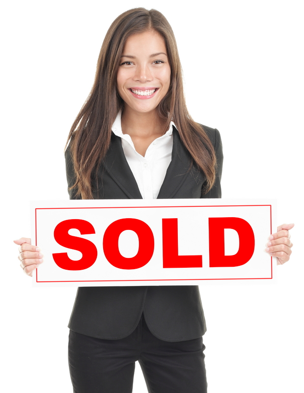 woman-with-sold-sign.jpg