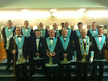 Worshipful Master Ken Ginnett, Abbey Masonic Lodge 180, pictured with his Wardens and Officers after his installation ceremony