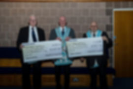 Worshipful Master, W.Bro. Lee Burnside presents a cheque for £500 to W.Bro. John McIlwaine and W.Bro. Foster Clyde on behalf of the N.I. Hospice.