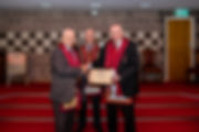 E.Comp. Bobby Spiers, accompanied by E.Comp. Gary Spiers presents E.Comp. Freddie Hoy with his 25 Year Certificate and Jewel.