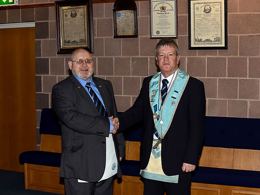 W.M. Terry Moore congratulating Bro. Hugh Blair after received his F.C. degree.