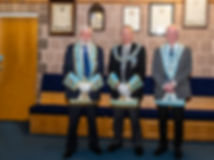 Worshipful Master  Lee Burnside accompanied by Provincial Deputy Grand Master R.W. Bro. Kenneth Doherty and Very Worshipful Bill McClenaghan, Past Grand Lodge Standard Bearer.
