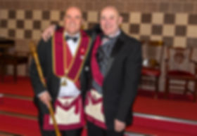 The outgoing Excellent King, Stephen Houston, congratulating the new Excellent King, Robert Lenaghan