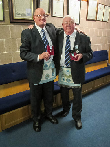 "W. Brothers ""in arms"" proudly showing off their 60 and 50 year jewels"