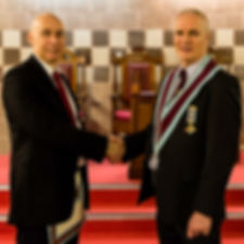 Installing Officer, Bro. Simon Lusty congratulates V.W.M. Gary Spiers after his installation.