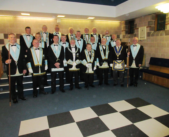 W.M. Stephen Bell accompanied by Grand and Provincial Grand Officers from Ireland and England, and also Lodge Officers.