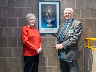 R.W.Bro. Bobby Spiers accompanied by his wife Jean at the unveiling of his Portrait at the the Whiteabbey Masonic Centre. The Portrait now hangs in the Ante-room outside the Craft Lodge room.