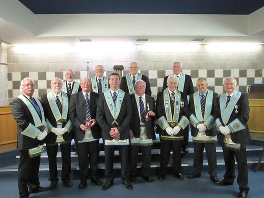 W.M. Stephen Bell acompanied by W.B. Frank McNeice, Richard Bell and Provincial Officers at their 60th and 50th award ceremoney.