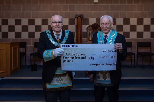 W.M. Neil Ritchie presents a cheque to R.Wor. Bro. J.O. Dunlop, Provincial Deputy Grand Master for £450 on behalf of the   Right Worshipful Provincial Grand Master, R.W. Bro. John Dickson chosen external Charity, Action Cancer.